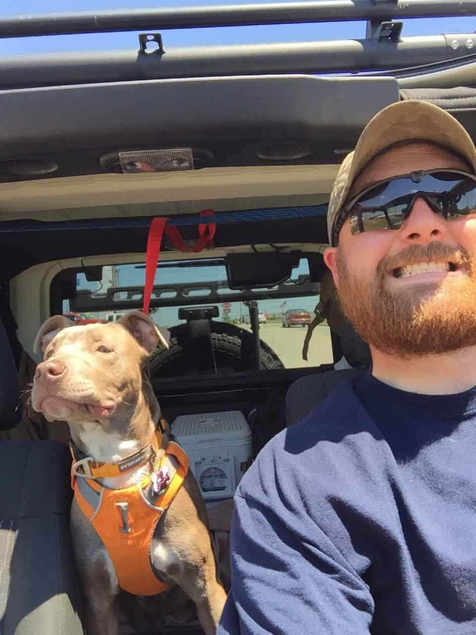 Bill Clark and his dog Boba Fett in his jeep