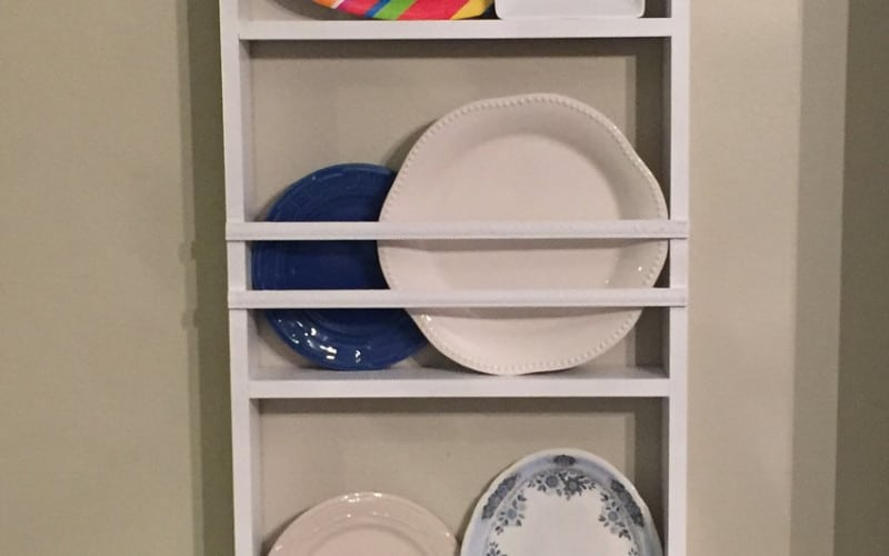 Platter display rack with several platters in it