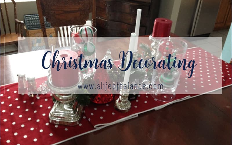 Holiday tablescape with red, silver, and green