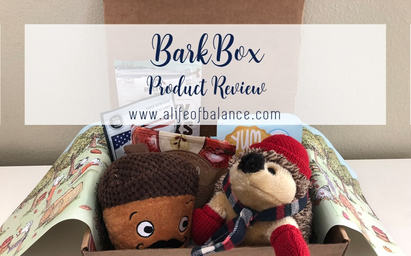 Open BarkBox showing dog toys and treats with article title - BarkBox Product Review www.alifeofbalance.com