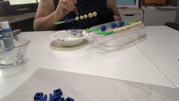 Brush painting beads for a diy garland ~ alifeofbalance.com