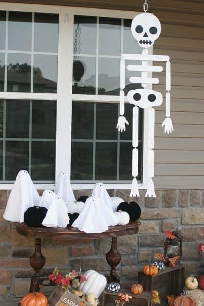 Skeleton, ghost, and pumpkin halloween decorations