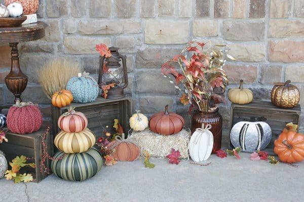 Pumpkin decorations on a fall porch