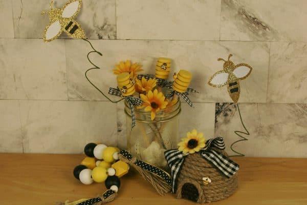 Bee decor with a yellow tinted mason jar - https://alifeofbalance.com/tinted-mason-jars/