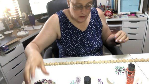Laying out a wood bead garland ~ alifeofbalance.com