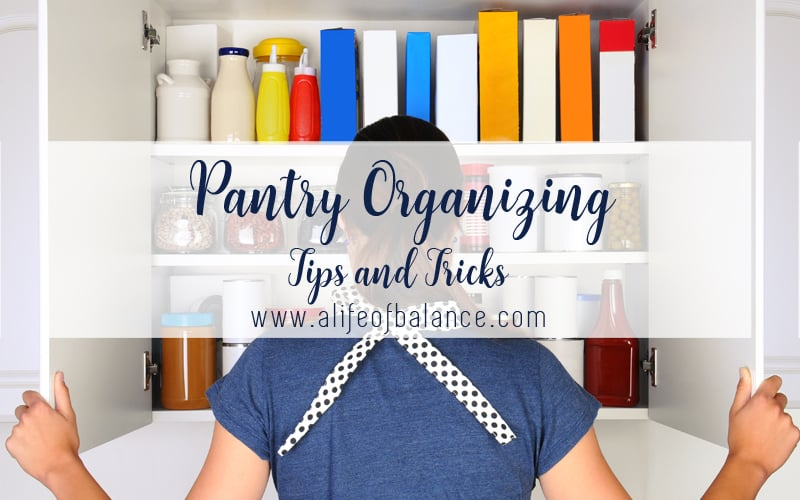 Woman looking at pantry organization with article title - Pantry Organizing Tips and Tricks www.alifeofbalance.com